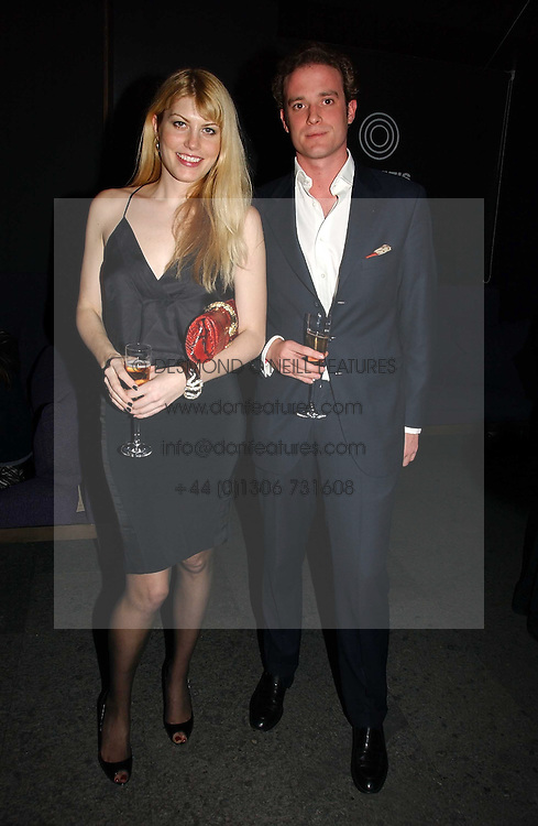 MEREDITH OSTROM and RICCARDO LANZA at a party to launch Three's A Crowd held at the Mayfair Hotel, Berkley Street, London on 5th December 2006.<br /><br />NON EXCLUSIVE - WORLD RIGHTS