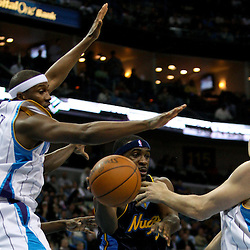 Dec 18, 2009; New Orleans, LA, USA;  Denver Nuggets guard Ty Lawson (3) passes the ball as New Orleans Hornets forward Darius Songaila (9) and forward James Posey (41) defend during the second half at the New Orleans Arena. The Hornets defeated the Nuggets 98-92. Mandatory Credit: Derick E. Hingle-US PRESSWIRE