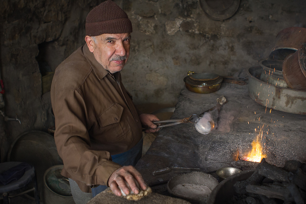 An old coppersmith in his workshop in Mardin, Turkey.