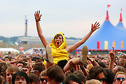 READING, ENGLAND - AUGUST 23:  A music fan soaks up the atmopshere as Bring Me The Horizon perform live on the main stage during day one of Reading Festival at Richfield Avenue on August 23, 2013 in Reading, England.  (Photo by Simone Joyner/Getty Images)