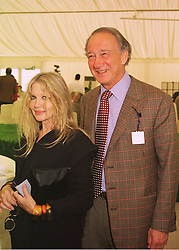 LORD & LADY WEINBERG, she is designer Anouska Hempel, at a polo match in Berkshire on 14th June 1998.MII 128