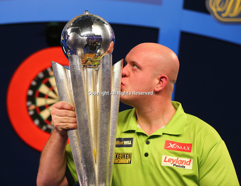02.01.2017. Alexandra Palace, London, England. William Hill PDC World Darts Championship final  between top seeds Michael van Gerwen (1) and Gary Anderson (2). Michael van Gerwen celebrates winning the World Darts Final and kisses the Trophy, after beating Defending World Champion Gary Anderson 7 sets to 3