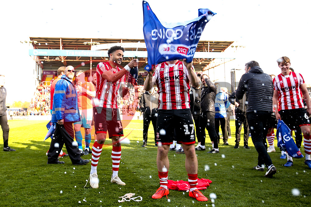 Bruno Andrade and Shay McCartan of Lincoln City celebrate winning promotion from Sky Bet League Two to Sky Bet League One - Mandatory by-line: Robbie Stephenson/JMP - 13/04/2019 - FOOTBALL - Sincil Bank Stadium - Lincoln, England - Lincoln City v Cheltenham Town - Sky Bet League Two