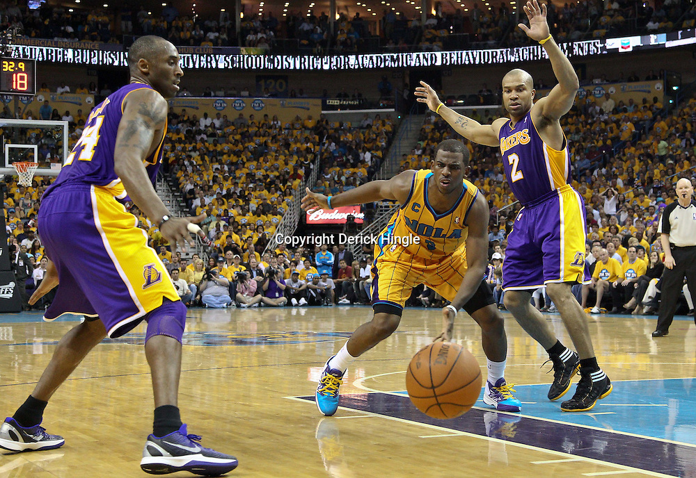 April 22, 2011; New Orleans, LA, USA; New Orleans Hornets point guard Chris Paul (3) watches after Los Angeles Lakers point guard Derek Fisher (2) knocks away the ball during the second quarter in game three of the first round of the 2011 NBA playoffs at the New Orleans Arena.    Mandatory Credit: Derick E. Hingle