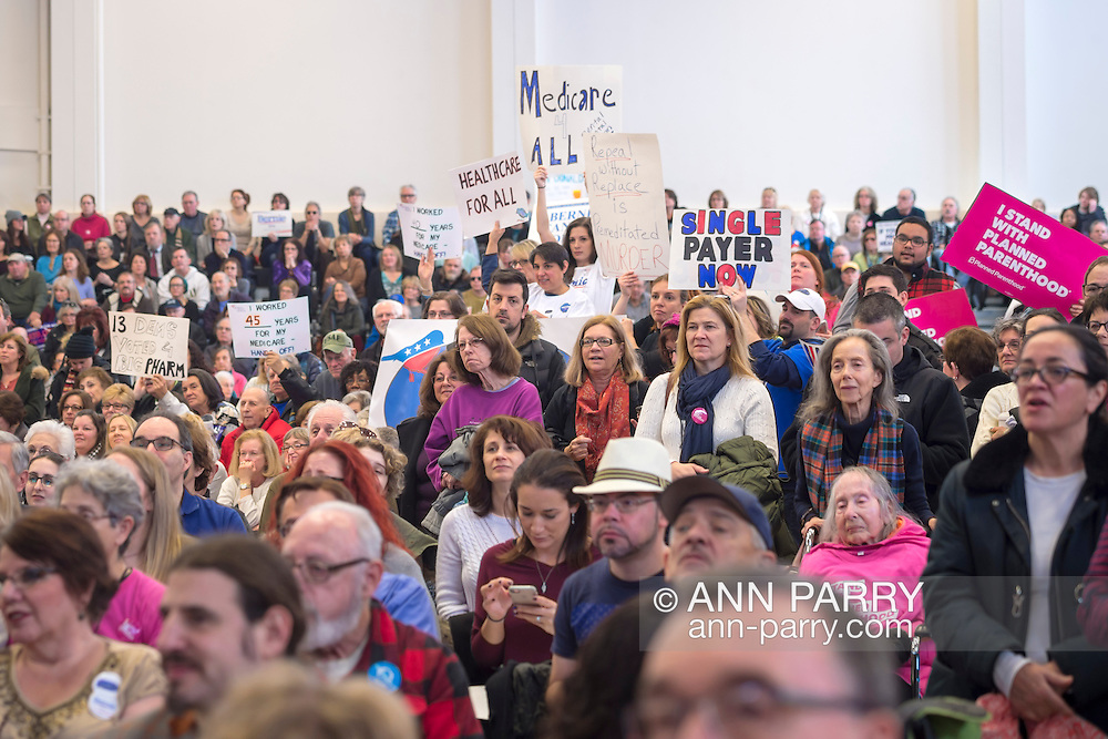 """Westbury, New York, USA. January 15, 2017. Hundreds of people, many with protest signs, are in the audience at the """"Our First Stand"""" Rally against Republicans repealing the Affordable Care Act, ACA, taking millions of people off health insurance, making massive cuts to Medicaid, and defunding Planned Parenthood. It was one of dozens of nationwide Bernie Sanders' rallies for health care that Sunday."""