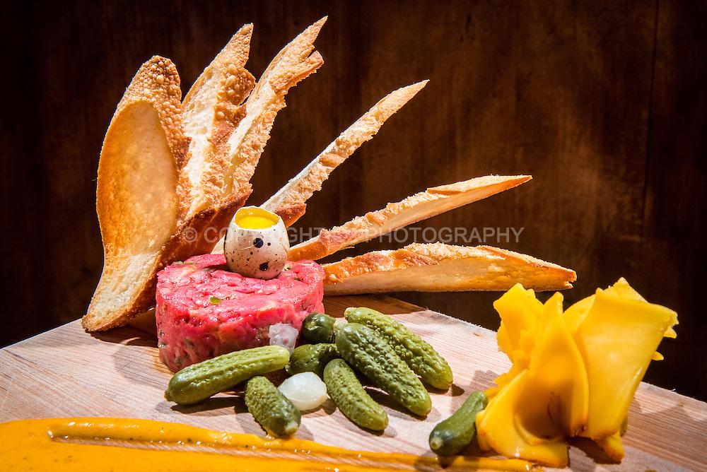 """The Admiral's famous """"Beef Tenderloin Tartare"""" -- 64 Degree Egg, Gran Cacio, Cornichons, Sriracha Aioli, Apple, Toast."""