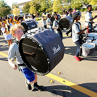 The drumline of the Tupelo High School Marching Band plays as they march in the Tupelo High School Homecoming Parade Thursday afternoon in Tupelo.