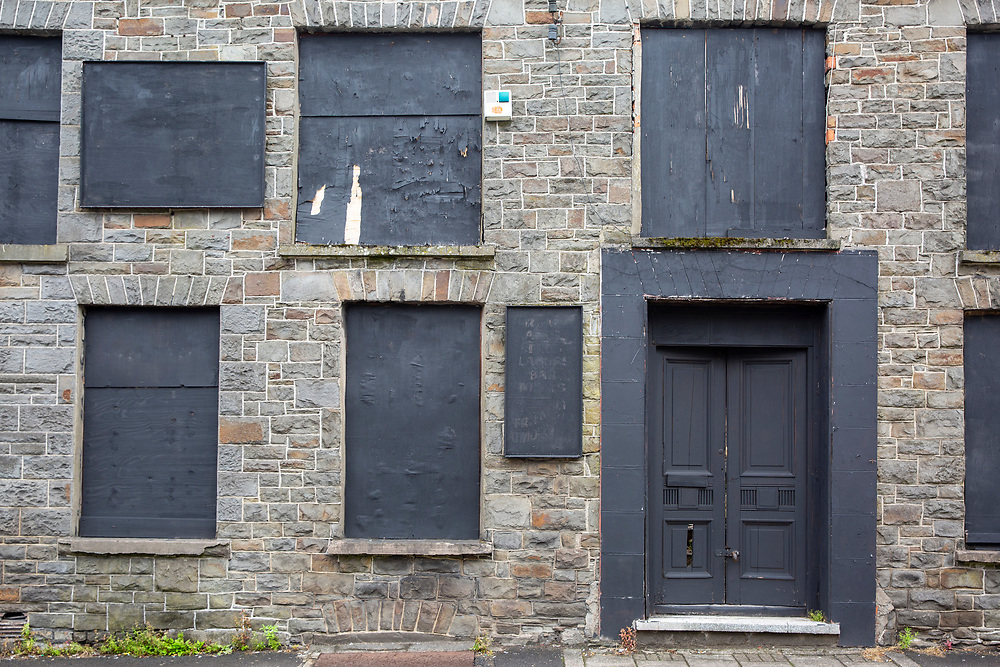Black boards cover up the windows and doors of the derelict Pentre Inn, Pentre village, Rhondda Valley, South Wales, UK.  (photo by Andrew Aitchison / In pictures via Getty Images)