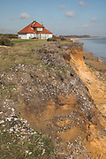 Coastal erosion of soft sandy cliffs at Easton Bavents, near Southwold, Suffolk, England