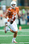 AUSTIN, TX - AUGUST 30:  David Ash #14 of the Texas Longhorns scrambles against the North Texas Mean Green on August 30, 2014 at Darrell K Royal-Texas Memorial Stadium in Austin, Texas.  (Photo by Cooper Neill/Getty Images) *** Local Caption *** David Ash