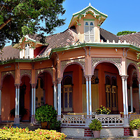 """Casa Román on Manga Island in Cartagena, Colombia<br /> This exquisite, 19th century Moorish mansion along Calle 25 on Manga Island is the life-long residence of Teresita Román Vélez and her collection of 1,500 dolls from around the world.  Her countless civil contributions to Cartagena earned her the title of honorary mayor in 2006. A noted chief and writer, she published her first collection of local recipes in 1963 called """"Cartagena de Indias en la Olla"""" which means Cartagena in the Pot. Since then, her books have sold over 600,000 copies.  This splendid home should not be confused with the Hotel Casa Cordoba Román in Old Town."""