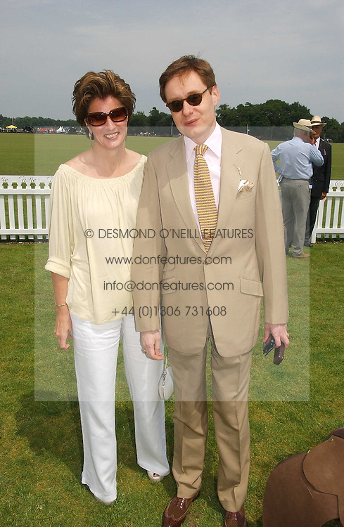 NICK & ALEX FOULKES at the Queen's Cup polo final sponsored by Cartier at Guards Polo Club, Smith's Lawn, Windsor Great Park on 18th June 2006.  The Final was between Dubai and the Broncos polo teams with Dubai winning.<br />