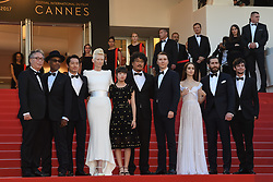 Byung Heebong, Steven Yeun, Giancarlo Esposito, Tilda Swinton, Ahn Seo-Hyun, director Bong Joon-Ho, Paul Dano, Lily Collins, Jake Gyllenhaal and Devon Bostic arriving on the red carpet of 'Okja' screening held at the Palais Des Festivals in Cannes, France on May 19, 2017 as part of the 70th Cannes Film Festival. Photo by Nicolas Genin/ABACAPRESS.COM
