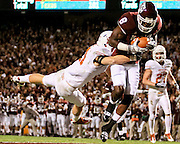 November 26, 2009; College Station, TX USA; Texas A&M wide receiver Jeff Fuller (8) catches a touchdown pass while defended by Texas safety Blake Gideon (21) in the first half at Kyle Field. Mandatory Credit: Thomas Campbell-US PRESSWIRE