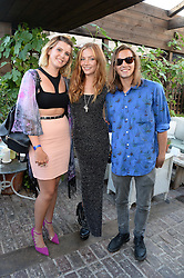 Left to right, GEORGIA LEWIS ANDERSON, CLARA PAGET and OSCAR TUTTIETT attending the Warner Bros. & Esquire Summer Party held at Shoreditch House, Ebor Street, London E1 on 18th July 2013.