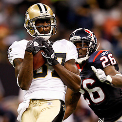 August 21, 2010; New Orleans, LA, USA; New Orleans Saints wide receiver Adrian Arrington (87) catches a deep pass over Houston Texans safety Eugene Wilson (26) during the second quarter of a preseason game at the Louisiana Superdome. Mandatory Credit: Derick E. Hingle