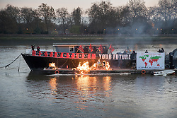 "© Licensed to London News Pictures. 26/11/2016. London, UK. Joe Corre, the son of former Sex Pistol manager Malcolm McLaren and Vivienne Westwood burns his personal collection of Sex Pistols punk memorabilia on a boat moored on The River Thames near Chelsea. Earlier this week Joe Corre said that punk has become nothing more than a ""McDonald's brand ... owned by the state, establishment and corporations"". His collection is estimated to be worth £5 million. Photo credit: Peter Macdiarmid/LNP"