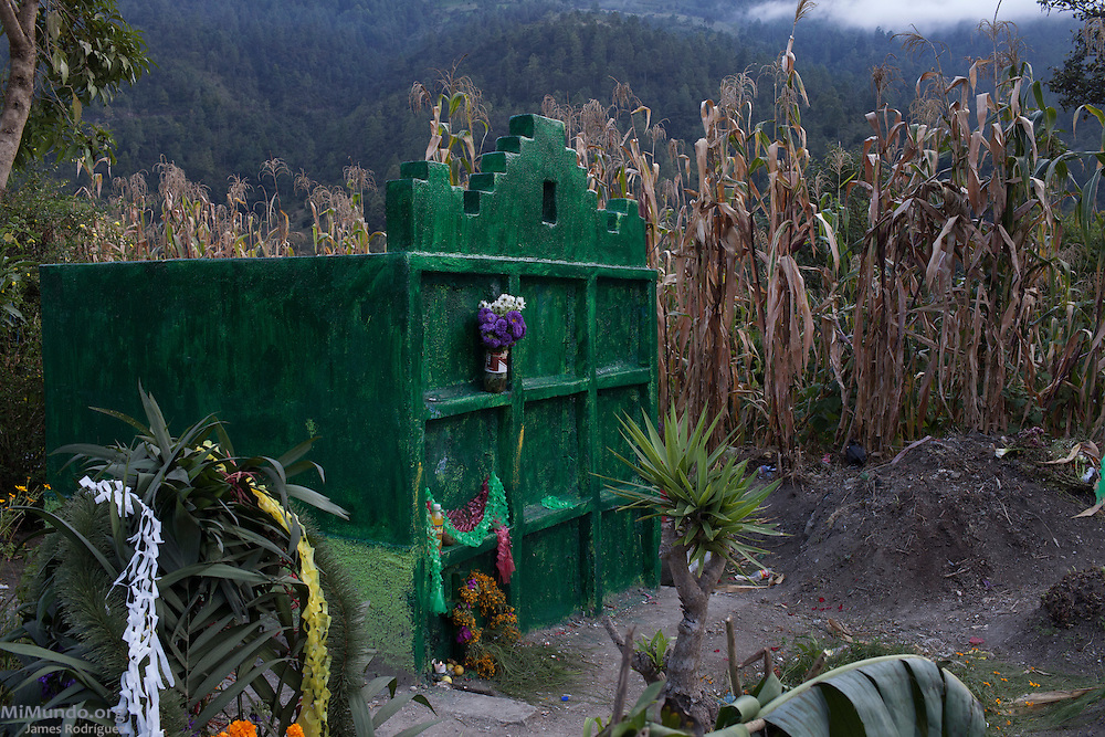 Graves in San Miguel Acatán, highland town made up mostly of Akatek Mayans, during Day of the Dead in the local cemetery. A syncretic holiday that blends Catholic Christian beliefs with local mayan customs, Day of the Dead is of high importance in many communities in Guatemala and Mexico. San Miguel Acatán, Huehuetenango, Guatemala. November 2, 2012.