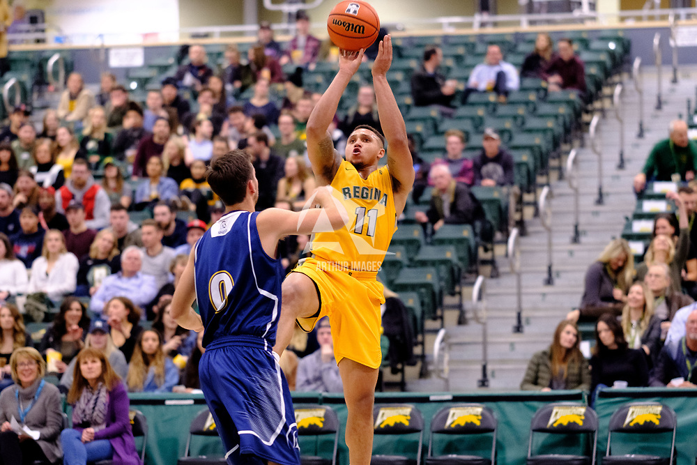 4th year guard, Myles Hamilton (11) of the Regina Cougars in action during the Regina Cougars vs Lethbridge game on November 2 at University of Regina. Credit Matte Black Photos/©Arthur Images 2018