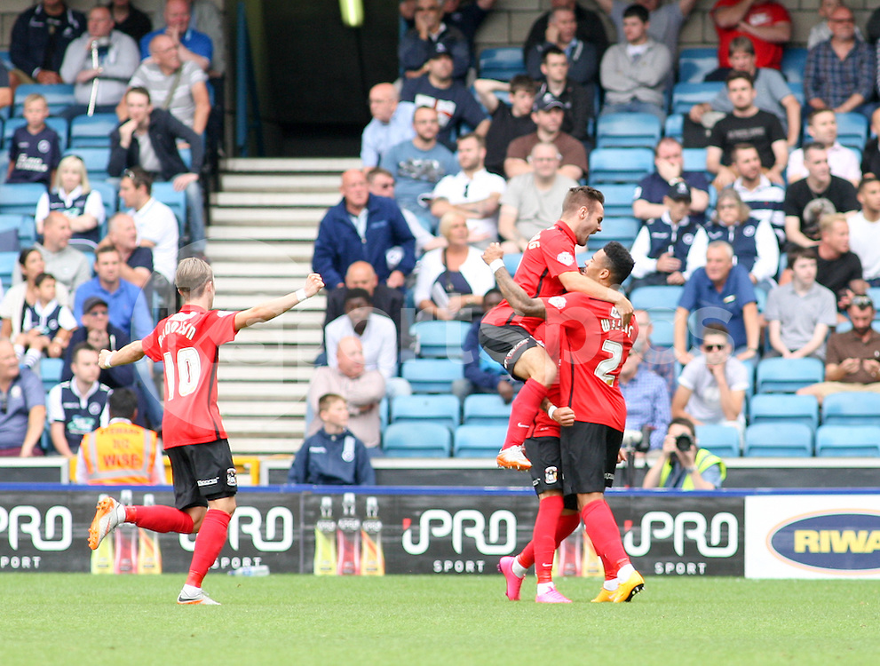 Coventry City players celebrate the goal of Ruben Lameiras of Coventry City to make it 2-0 during the Sky Bet League 1 match between Millwall and Coventry City at The Den, London, England on 15 August 2015. Photo by Edmund  Boyden.