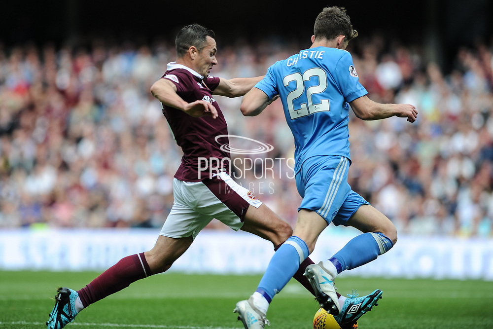 Will Cowie and Ryan Christie battle for the ball during the Ladbrokes Scottish Premiership match between Heart of Midlothian and Aberdeen at Murrayfield, Edinburgh, Scotland on 9 September 2017. Photo by Kevin Murray.