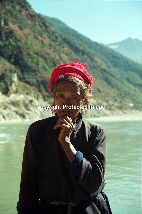 """DIQING COUNTY, DECEMBER 19, 2000: A Tibetan nomad stands at a creek, Yunnan province , December 19, 2000..DIQING county is believed to be part of the areas on which James Hilton's famous novel """" lost Horizon""""- a description of Shangri-La- is modelled.. ."""