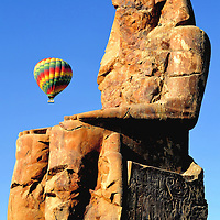 Colossi of Memnon Statue of Amenhotep III with Hot Air Balloon near Luxor, Egypt<br />