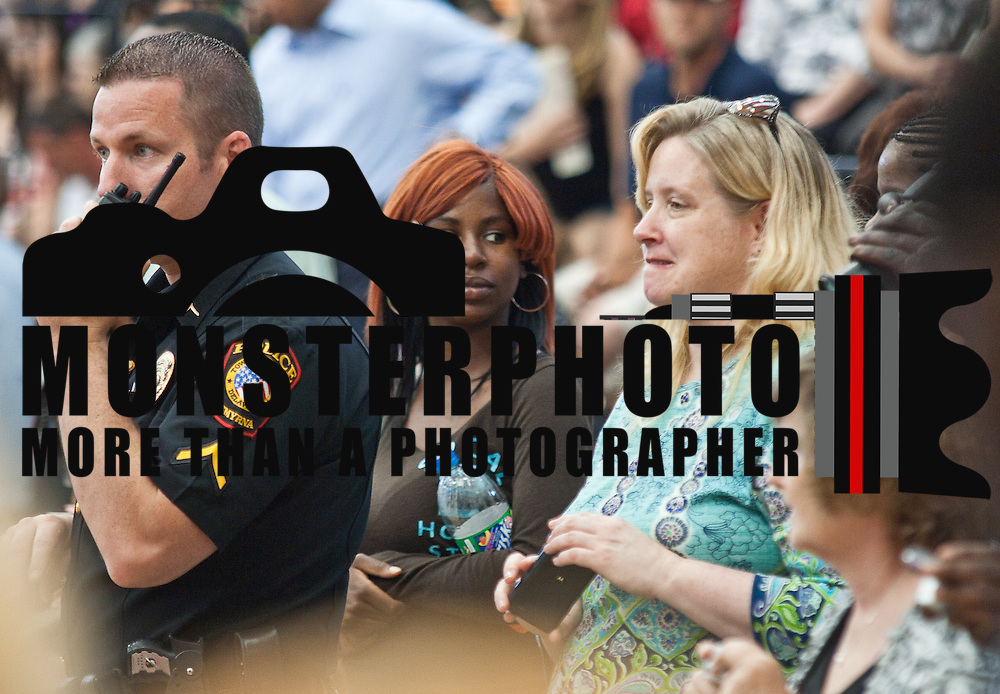 06/02/12 Smyrna Del: Smyrna police officer uses he's radio  during Smyrna commencement exercise Saturday, June 2 2012, at Smyrna High School in Smyrna Delaware...Special to The News Journal/SAQUAN STIMPSON