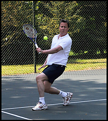 File pictures of The Prime Minister David Cameron and Boris Becker playing in a Charity tennis match at Chequers, Saturday April 30  2011. The PM said he has started teaching son Elwyn, 7, how to play tennis. Picture by Andrew Parsons / i-Images<br /> File Photo - Tennis match with Cameron auctioned off for £160,000 at Tory fundraiser on Wednesday. The wife of a former Russian minister is to pay the Conservatives £160,000 to play a game of tennis with Prime Minister David Cameron and London Mayor Boris Johnson. Photo filed Friday 4th July 2014.