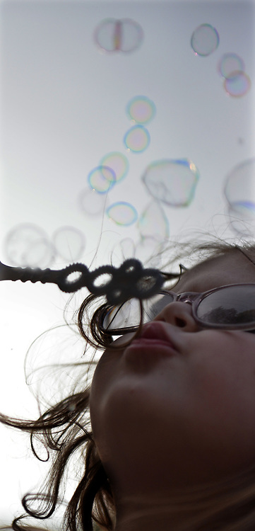 YARMOUTH, Maine --  7/21/17 --   Kimber Sprague, 4, of Auburn blows bubbles at the Clam Festival on Friday night. The Yarmouth Clam Festival parade drew thousands of visitors from around the region. Photo by Roger S. Duncan for the Forecaster