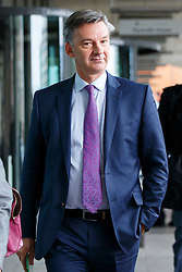 © Licensed to London News Pictures. 15/10/2015. London, UK. Chief Executive of SMMT, Mike Hawes leaving Portcullis House after giving evidence on diesel emissions and air quality to the Environmental Audit Committee in London on Thursday, 15 October 2015. Photo credit: Tolga Akmen/LNP