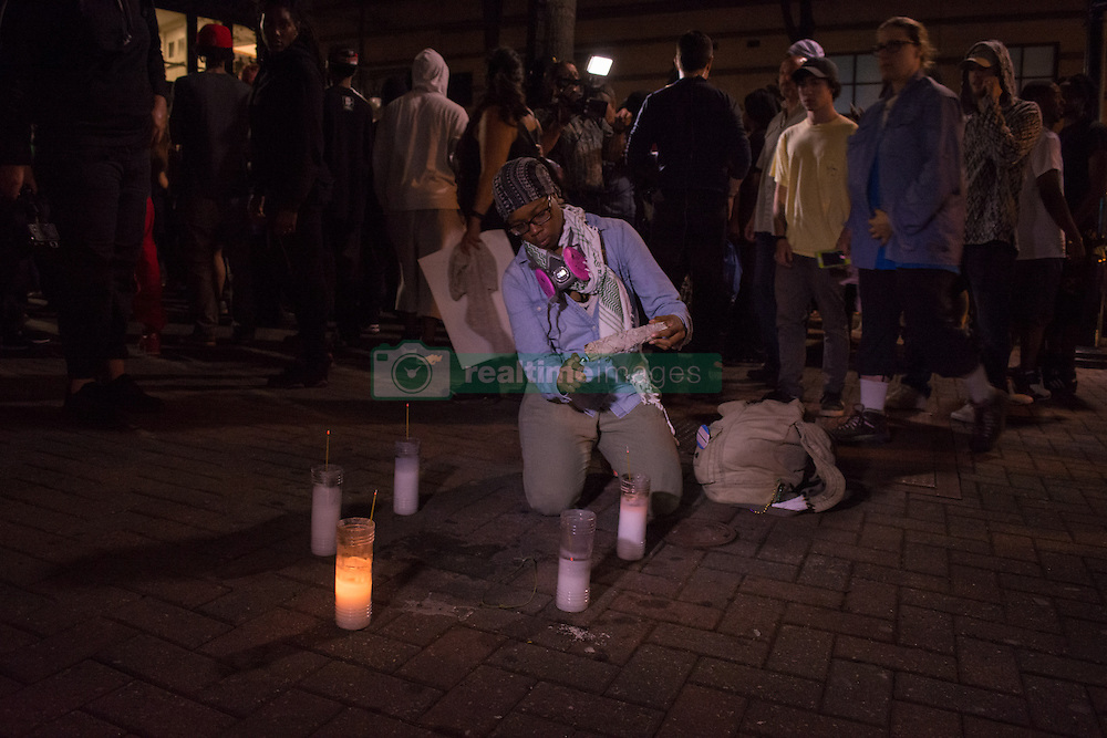 September 22, 2016 - Charlotte, North Carolina, U.S - Protesters light candles outside Omni Hotel where a protester, Justin Carr, killed on Wednesday. (Credit Image: © Dimitrios Manis via ZUMA Wire)