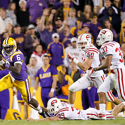November 12, 2011; Baton Rouge, LA, USA; LSU Tigers safety Craig Loston (6) runs back a muffed punt during the second quarter of a game against the Western Kentucky Hilltoppers at Tiger Stadium.  Mandatory Credit: Derick E. Hingle-US PRESSWIRE