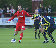 Gary Harkins runs at Brechin's Craig Malloy - Brechin City v Dundee, pre-season friendly at Dens Park<br /> <br />  - &copy; David Young - www.davidyoungphoto.co.uk - email: davidyoungphoto@gmail.com