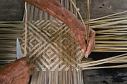 Weaving split cane<br /> Macushi people,<br /> Fairview Amerindian village<br /> Iwokrama Reserve<br /> GUYANA. South America