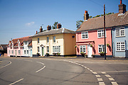 Traditional old houses line the road at the village of Alderton, Suffolk, England