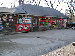 The Historic Elbow Inn Bar & Grill on Old US Route 66 near Devils Elbow, MO. Watering Hole built in 1929 backs to the Big Piney River at the Steel Truss Bridge and Original Alignment of Route 66.
