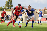 Morecambe Defender James Jennings and Carlisle united Danny Grainger battle for the ball during the EFL Sky Bet League 2 match between Morecambe and Carlisle United at the Globe Arena, Morecambe, England on 8 October 2016. Photo by Pete Burns.