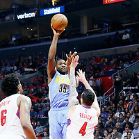 24 February 2016: Denver Nuggets forward Kenneth Faried (35) goes for the jump shot over Los Angeles Clippers guard J.J. Redick (4) during the Denver Nuggets 87-81 victory over the Los Angeles Clippers, at the Staples Center, Los Angeles, California, USA.
