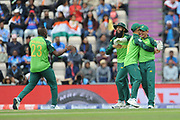 Quinton de Kock of South Africa is congratulated by JP Duminy, Hashim Amla and Andile Phehlukwayo during the ICC Cricket World Cup 2019 match between South Africa and India at the Hampshire Bowl, Southampton, United Kingdom on 5 June 2019.