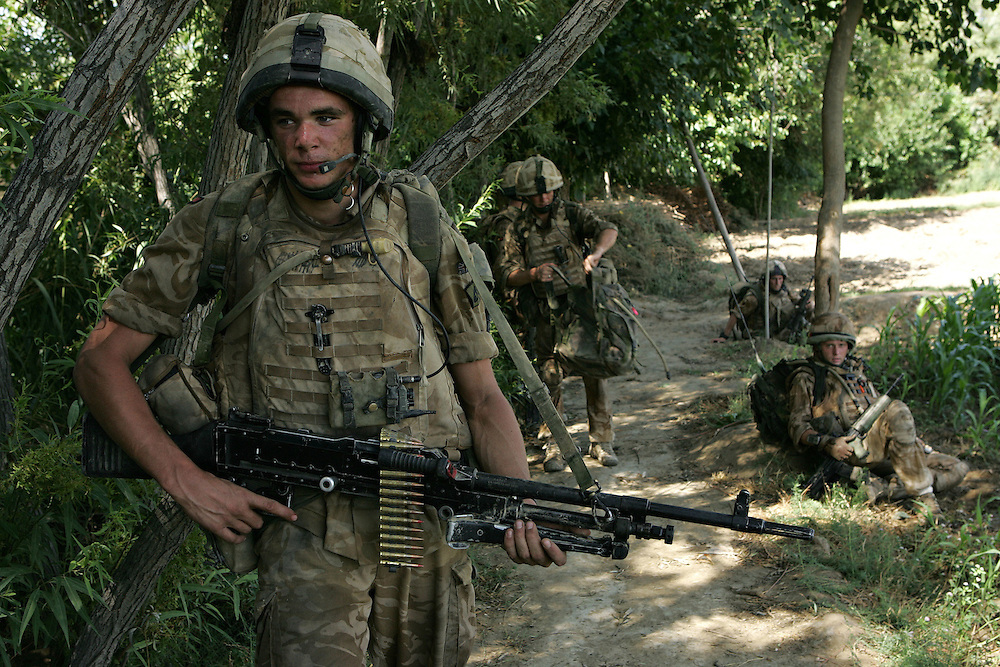 29/06/07.Sangin Valley, Helmand, Afghanistan.Soldiers from A Company 1 Battalion Royal Anglians, known as 'The Vikings' conduct operations against the Taliban in the Sangin Valley, Helmand province, Afghanistan on the 29th June 2007..The soldiers made a Tactical Advance to Battle over night carrying just food, water and ammunition. At first light they moved on their objectives; a series of compounds, orchards and paddy fields. During the day they exchanged fire with the enemy on a number of occasions. 13 Taliban were killed, 1 British soldier and 3 Afghan troops were wounded.