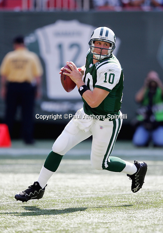 EAST RUTHERFORD, NJ - OCTOBER 1:  Quarterback Chad Pennington #10 of the New York Jets, with a replica jersey of famous Jets quarterback Joe Namath appearing in the background, rolls out against the Indianapolis Colts at the Meadowlands on October 1, 2006 in East Rutherford, New Jersey. The Colts defeated the Jets 31-28. ©Paul Anthony Spinelli *** Local Caption *** Chad Pennington