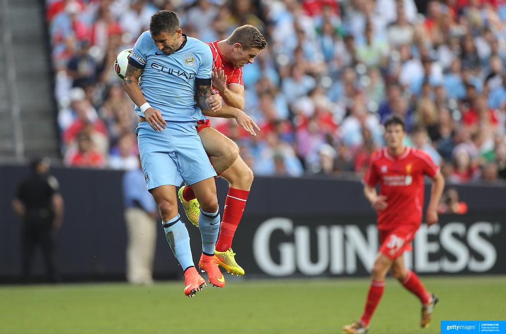 Aleksandar Kolarov, (left), Manchester City, and Jordan Henderson, Liverpool, challenge for the ball during the Manchester City Vs Liverpool FC Guinness International Champions Cup match at Yankee Stadium, The Bronx, New York, USA. 30th July 2014. Photo Tim Clayton