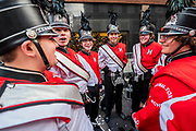 The Sussex hamiltion High School Charger Band have a laugh before the start - The New Years Day parade passes through central London.