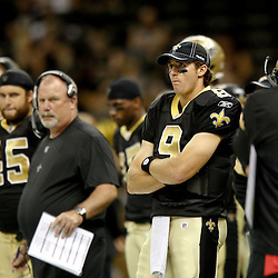 September 1, 2011; New Orleans, LA, USA; New Orleans Saints quarterback Drew Brees (9) watches from the sideline during the second half of a preseason game against the Tennessee Titans at the Louisiana Superdome. The Titans defeated the Saints 32-9. Mandatory Credit: Derick E. Hingle