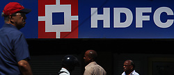 March 29, 2019 - Mumbai, India - People walk past in front of HDFC bank branch in Mumbai, India on 29 March 2019. The Bank has emerged as the best digital bank in India and awarded the title on the basis of its best-in-class digital banking initiatives by Asiamoney, a financial publication as per media report. (Credit Image: © Himanshu Bhatt/NurPhoto via ZUMA Press)
