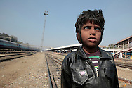 Badal is 8 years old and living homeless at the train station in Jaipur where he collects bottles to make a few rupees.  Children, some who have run away from their families, find themselves living homeless on the train tracks waititng for the next train to arrive at the train station in Jaipur, India.  Once the train arrives they raid the train looking for plastic bottles that they can then sell.  Most will make about $1.50/day but spend most of it on glue which they are most addicted to.