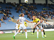 AFC Wimbledon defender Paul Robinson (6) heads clear under pressure during the Sky Bet League 2 match between Oxford United and AFC Wimbledon at the Kassam Stadium, Oxford, England on 10 October 2015.