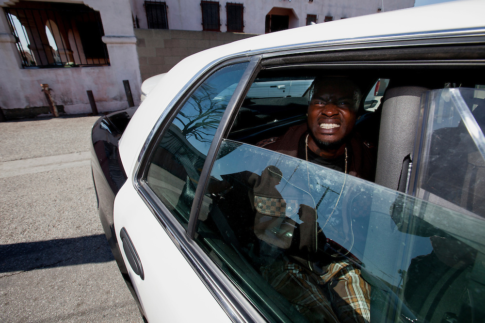 A gang member from the 83rd St. Crips is detained by Los Angeles police on Feb. 4, 2011. Los Angeles, Calif. (photo by Gabriel Romero ©2011)