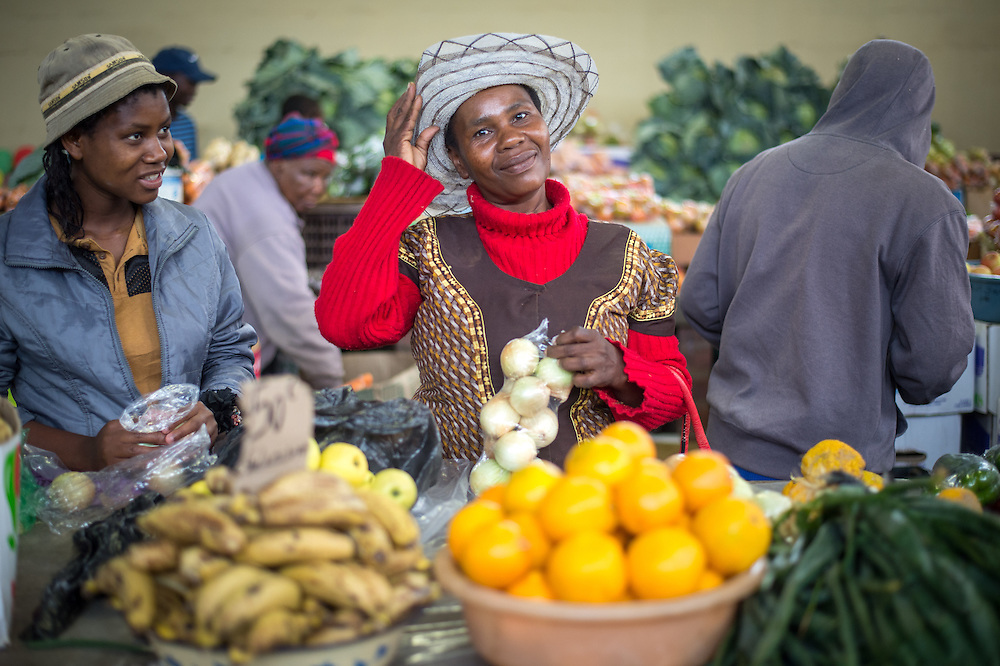 Women buying produce at the Manzini Wholesale Produce and Craft Market in Swaziland, Africa.